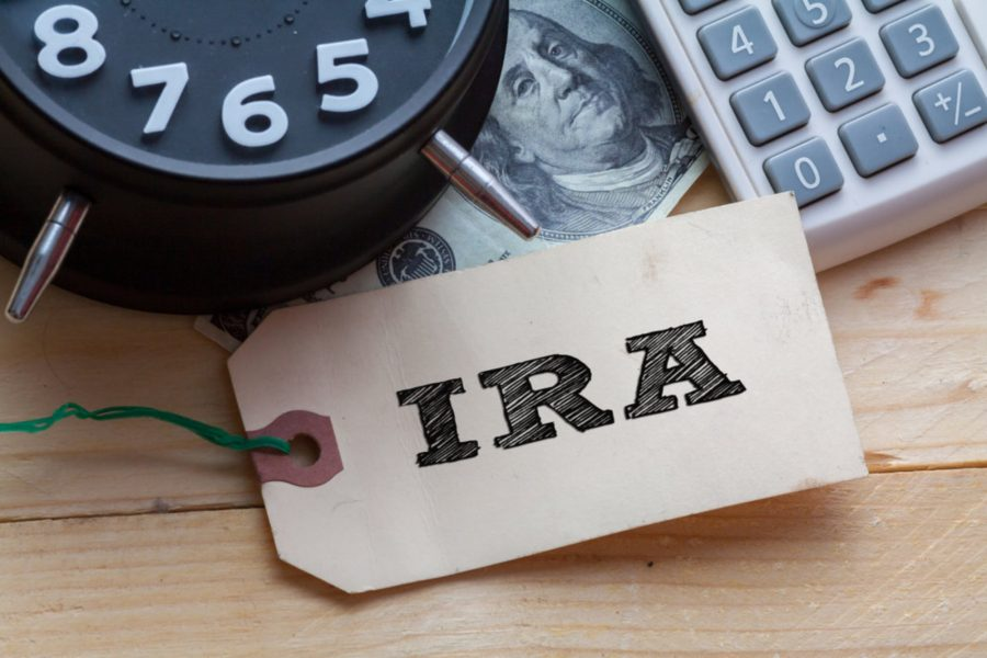 Photo of IRA tag with clock, money, and calculator