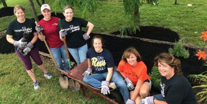 volunteers mulching and landscaping