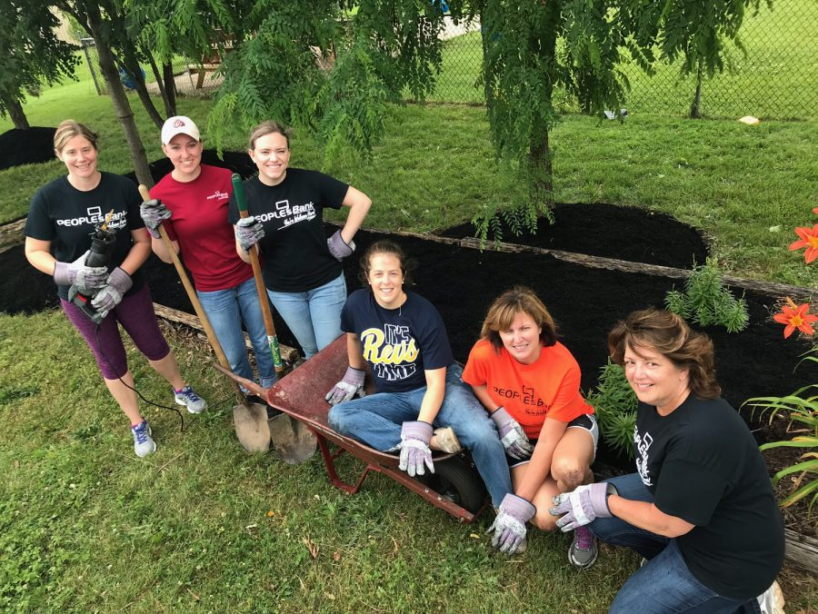 volunteers mulching and landscaping