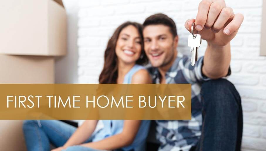 picture of couple holding up keys to their first home