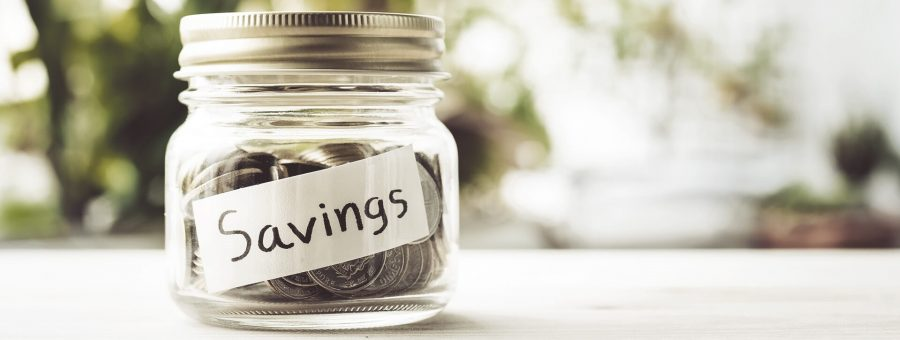photo of jar of coins with savings label on it