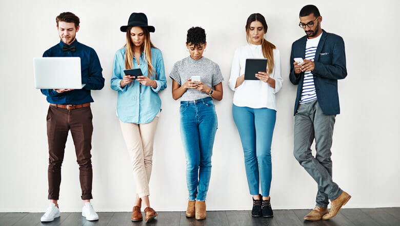 group of twenty somethings on electronic devices