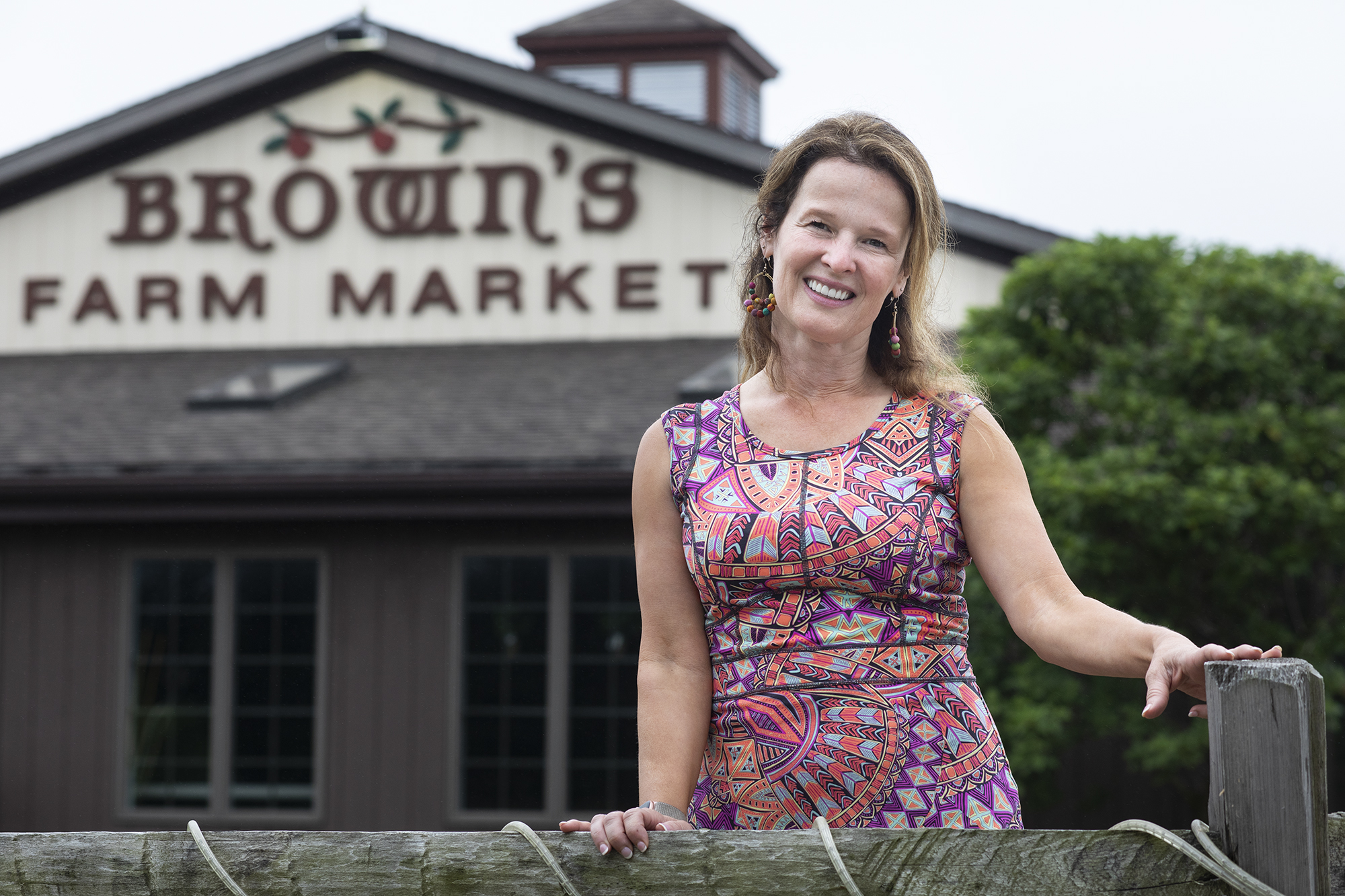 woman standing in front of farm market