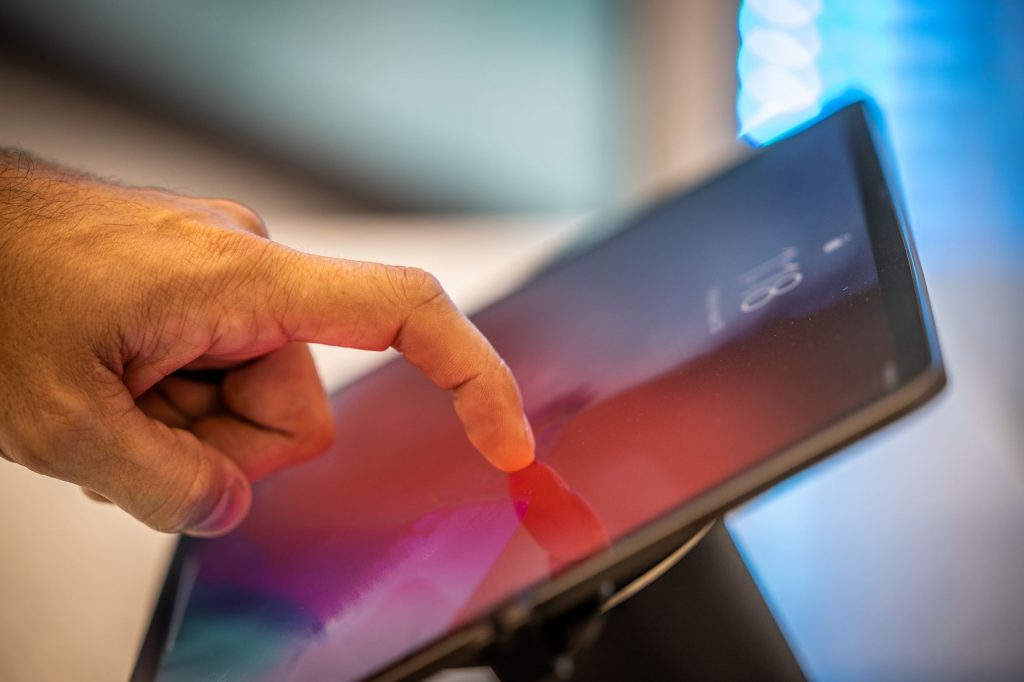 person touching iPad